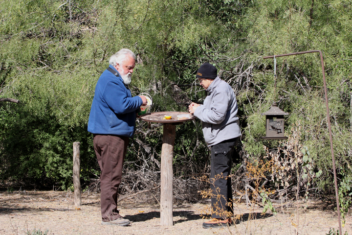Merle and Lois, two of the long-time volunteers, fill a feeding station.
