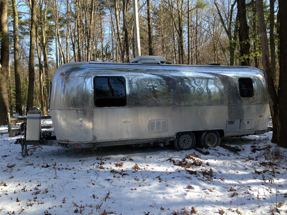 Airstream at rest in MA, badly needing a rinsing to remove road salt.  Hopefully, temperatures will rise a bit in the weeks ahead.