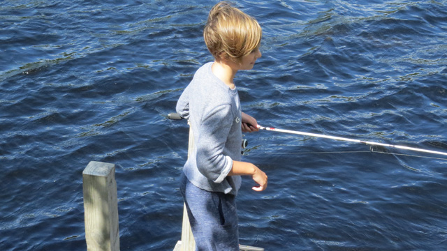 This young angler had a small bass on the other end of her pole.