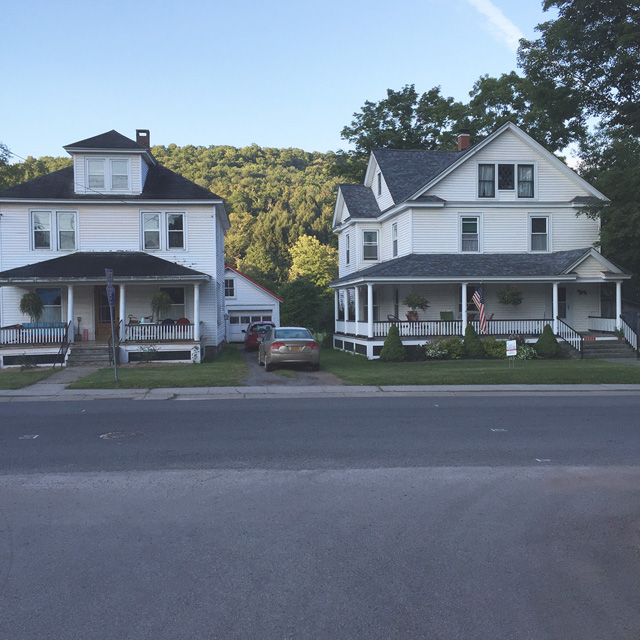 The front porch of the house on the right is an informal community gathering spot.